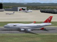 Screenshot of Northwest Airlines Boeing 747-400 on runway.
