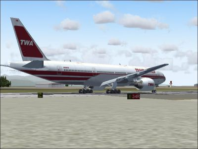 Screenshot of Trans World Airlines 777-236ER on runway.