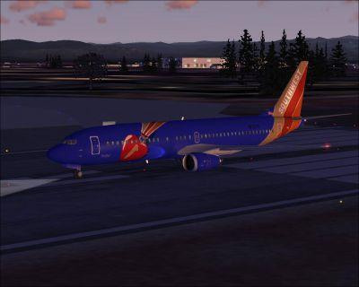 """Screenshot of Southwest Airlines Boeing 737-400 """"Triple Crown One"""" on runway."""