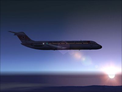 Turkish Airlines Douglas DC-9-30 in the sky at sunset.