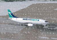 Screenshot of Westjet Boeing 737-700 on runway in the snow.