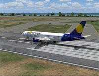 Screenshot of Air Santo Domingo Boeing 757-236 on runway.