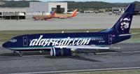 Screenshot of Alaska Air Boeing 737-700 on runway.