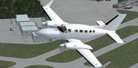 Screenshot of plain white Cessna 414 Chancellor in flight.