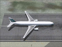 Top down view of Cathay Pacific Airways Boeing 777-367 on runway.