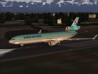 Screenshot of Korean Airlines McDonnell Douglas MD-11 on runway.