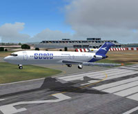 Screenshot of Saeta Air Ecuador Boeing 727-200 taking off from runway.