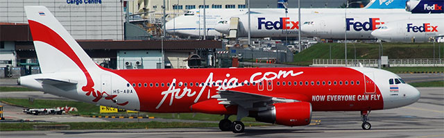 An Air Asia aircraft at an airport.