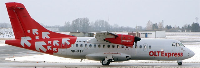 OLT Express Regional aircraft on runway.