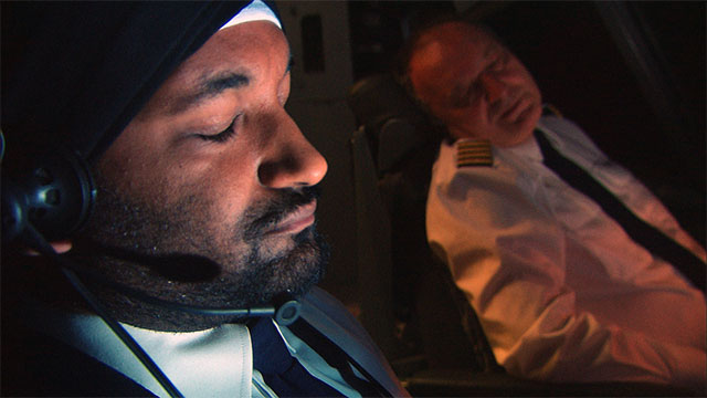 Two pilots asleep at controls of aircraft.
