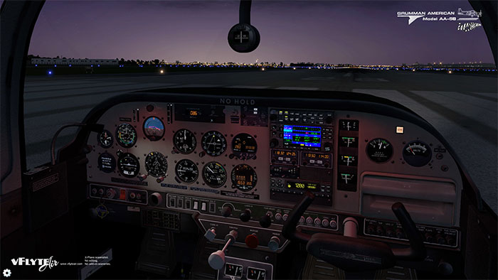 3D virtual cockpit with night lighting at dusk.