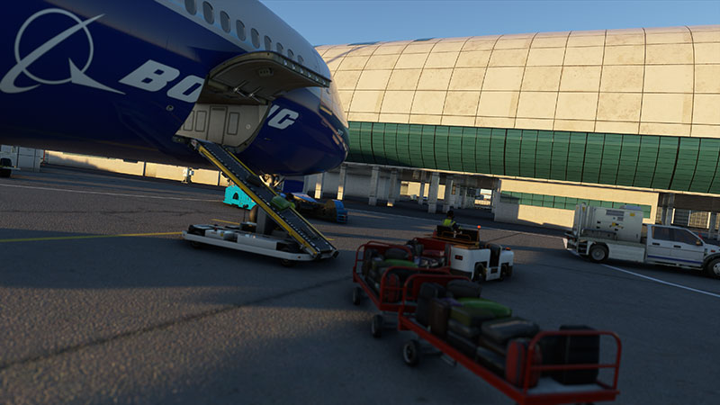 Boeing 787 side cargo door with loading underway.