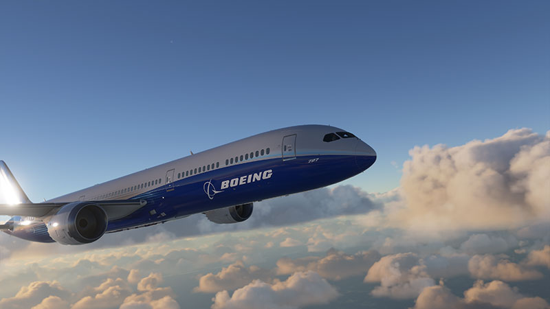 Boeing 787 stock aircraft in flight over clouds.