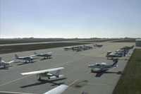 Numerous planes on the ground at McKinney Municipal Airport.