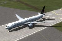 Screenshot of ANA Boeing 777-300ER on runway.