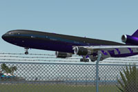 Screenshot of a carbon fiber McDonnell Douglas MD-11 taking off.