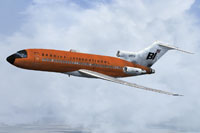 "Screenshot of ""Jellybean Orange"" Braniff Boeing 727-100 in flight."