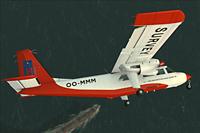 Screenshot of Britten Norman BN-2 Islander OO-MMM over the ocean.