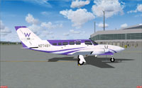 Side view of white and purple Cessna 402C on the ground.