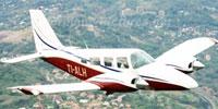 Image of Carmonair Piper Seneca II TI-ALH in flight.