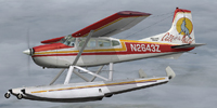 Screenshot of Cessna 185,  Skywagon F amphibian variant, in the air.