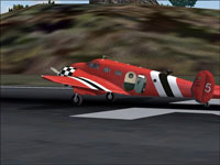 Screenshot of Circo Aereo Beech 18 on runway.