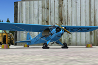 Screenshot of blue Piper J-3 Cub on the ground.
