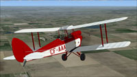Screenshot of DeHavilland Gipsy Moth CF-AAA in flight.