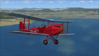 Screenshot of DeHavilland Gipsy Moth ZK-ADT in flight.