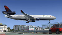 Screenshot of Delta Airlines McDonnell Douglas MD-11 landing at an airport.