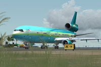 Screenshot of a bright blue/green Douglas MD-11 on runway.