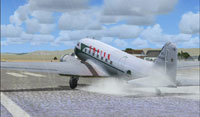 Screenshot of Empire Airlines Douglas DC-3 landing on runway.