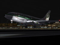 Screenshot of Evergreen Boeing 737-200F taking off at night.
