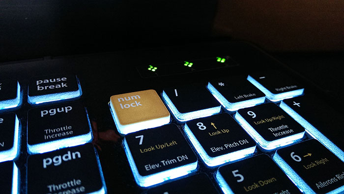 Indicator lights shaped like the Editors Keys logo/Colored Num Lock button changes the function of the number keys.