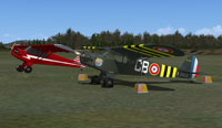 Screenshot of two French Piper Cubs on the ground.