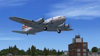 Boeing 307 departing KBMA.