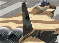 Screenshot of F-15C Eagle in desert camo on runway.
