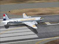 Screenshot of KLM Douglas DC-4-1009 on runway.