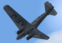 Looking up at KNILM Douglas DC-2 in flight.