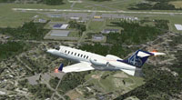 Screenshot of plane flying over Kinston Regional Jetport.
