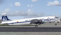Side view of LAC Colombia Douglas DC-6A taking off.
