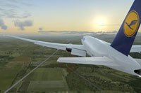 "Screenshot of Lufthansa Cargo ""Ola Brazil"" Boeing 777 flying towards the sunrise."