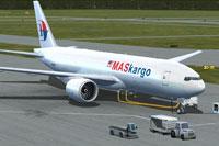 Screenshot of MASkargo Boeing 777-200LRF with ground services.