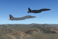 Screenshot of two McDonnell-Douglas F-15E's in flight.