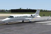 Screenshot of a metallic silver Learjet 45 on runway.