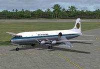 Mexicana Douglas DC-6 taxiing to runway.
