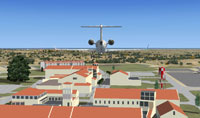 Screenshot of plane flying NAS Sigonella scenery.