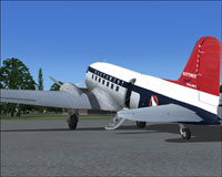 Northwest Orient Airlines Douglas DC-3 on the ground awaiting passengers.