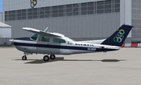 Side view of Olympic Aviation Cessna T210 Centurion.