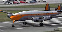 Screenshot of orange Lockheed L749 Constellation on runway.